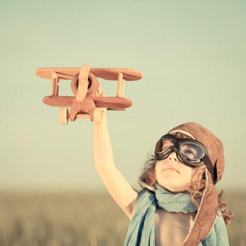 sf-vintage-girl-flying-airplane-toy.jpg